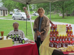 Len and Mother-In-law, Gloria, in the  Wolgast Tree Farm & Apiary booth at Duke Farms Farm To Table Market in Hillsborough.